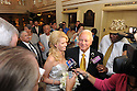 Trina Grimes Scott and former Governor Edwin Edwards greet the media after getting married in the French Quarter in New Orleans, La., Friday, July 29, 2011. Edwards was recently released from prison where he served eight years on corruption charges.....(AP Photo/Cheryl Gerber)