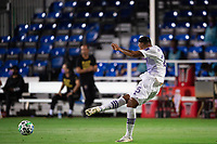LAKE BUENA VISTA, FL - AUGUST 11: Antonio Carlos #25 of Orlando City SC kicks the ball during a game between Orlando City SC and Portland Timbers at ESPN Wide World of Sports on August 11, 2020 in Lake Buena Vista, Florida.