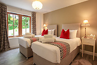 BNPS.co.uk (01202) 558833. <br /> Pic: Bidwells/BNPS<br /> <br /> Pictured: Twin bedroom.<br /> <br /> Better than a gravy boat...<br /> <br /> A striking country house built by a bishop as a wedding gift for his son is on the market for offers over £2m.<br /> <br /> Dunbeg House sits in an incredible position on the bank of a loch with stunning panoramic water and mountain views.<br /> <br /> The impressive property not only includes the five-bedroom main house, but also a two-bedroom cottage that has been run as a successful holiday let and over four acres of woodland garden.