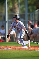 Northeastern Huskies catcher John Mazza (15) bats during a game against the South Dakota State Jackrabbits on February 23, 2019 at North Charlotte Regional Park in Port Charlotte, Florida.  Northeastern defeated South Dakota State 12-9.  (Mike Janes/Four Seam Images)
