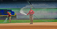 8 June 2013: Washington Nationals Groundskeepers water the infield prior to a game against the Minnesota Twins at Nationals Park in Washington, DC. The Twins edged out the Nationals 4-3 in 11 innings. Mandatory Credit: Ed Wolfstein Photo *** RAW (NEF) Image File Available ***