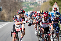 """""""...or you prefer a Mars bar?"""" <br /> > Rafał Majka (POL/UAE-Emirates) distributing essentials to teammate Jan Polanc (SVN/UAE-Emirates) working at the front of the race<br /> <br /> Stage 6 from Castelraimondo to Lido di Fermo (169km)<br /> <br /> 56th Tirreno-Adriatico 2021 (2.UWT) <br /> <br /> ©kramon"""