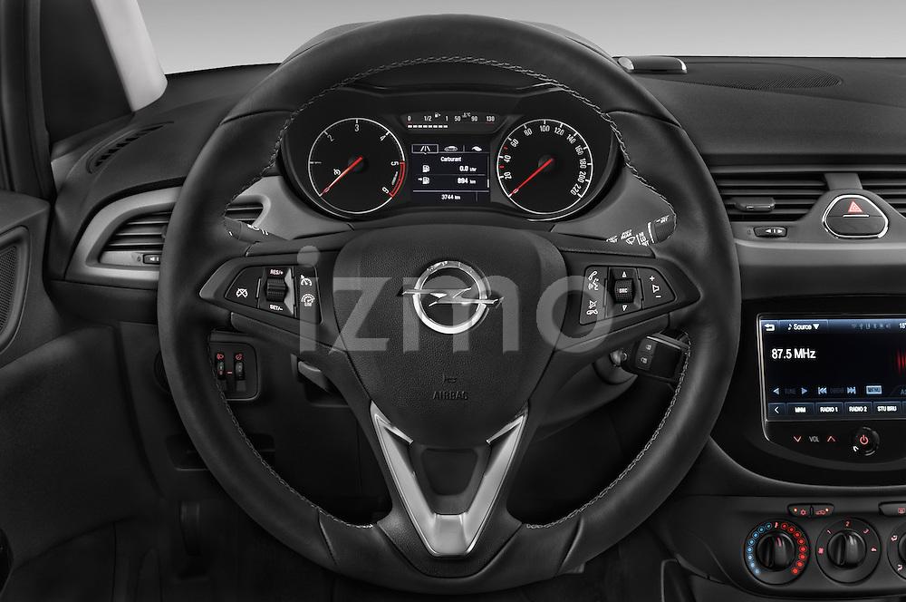 Car pictures of steering wheel view of a 2015 Opel CORSA Enjoy 5 Door Hatchback Steering Wheel