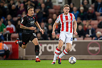 1st October 2021;  Bet365 Stadium, Stoke, Staffordshire, England; EFL Championship football, Stoke City versus West Bromwich Albion; Harry Souttar of Stoke City under pressure from  Jordan Hugill of West Bromwich Albion