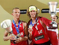 Latvia's Janis Smedins, left, and<br /> Aleksandrs Samoilovs Lettonia hold the second place's trophies at the end of the men's final match between Usa and Latvia at the Beach Volleyball World Tour Grand Slam, Foro Italico, Rome, 23 June 2013. USA defeated Latvia 2-0.<br /> UPDATE IMAGES PRESS/Isabella Bonotto