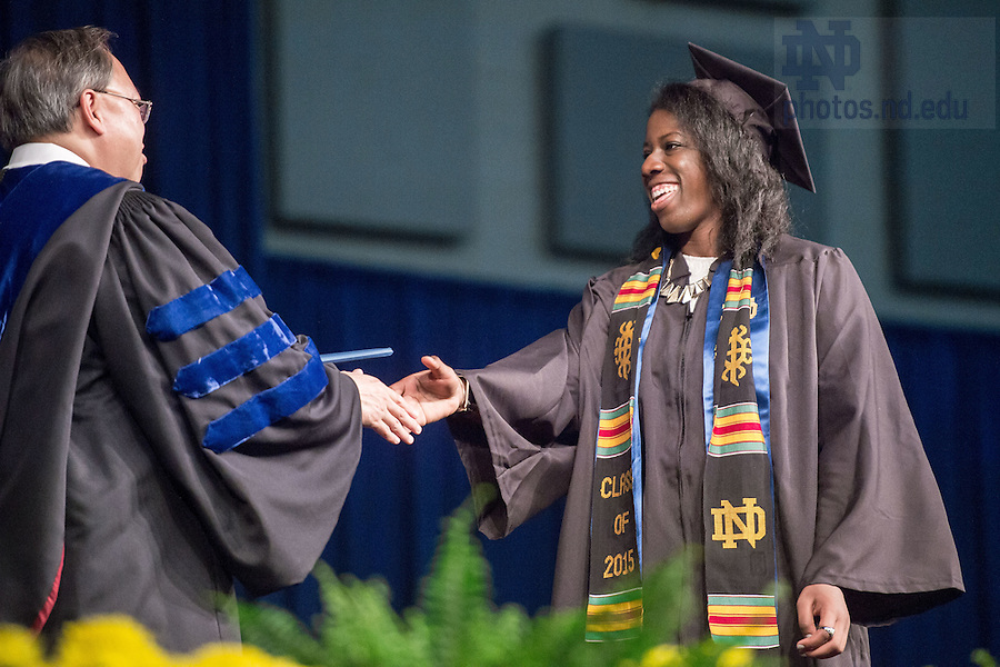 May 17, 2015; Former volleyball player Toni Alugbue receives her diploma from Dean Roger Huang at the Mendoza College of Business Undergraduate Commencement. (Photo by Matt Cashore/University of Notre Dame)