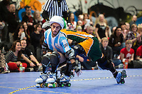 16 MAR 2014 - BIRMINGHAM, GBR - Argentine jammer El Pibe avoids a challenge from Wizard of Aus blocker Flamin' Galah during the bout between the two teams at the inaugural Men's Roller Derby World Cup in the Futsal Arena in Birmingham, West Midlands, Great Britain (PHOTO COPYRIGHT © 2014 NIGEL FARROW, ALL RIGHTS RESERVED)