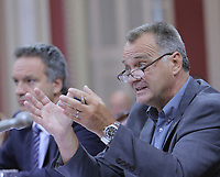 Ronald Morin, president of the Regroupement des Associations de Pompier du Quebec (RAPQ) gestures as he speaks at the parliamentary commission on Bill 3 at the National Assembly in Quebec City, Thursday August 21, 2014.<br /> <br /> PHOTO :  Francis Vachon - Agence Quebec Presse