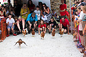 04/08/19<br /> <br /> In a flap.<br /> <br /> Hundreds of spectators watch as competitors race their hens at the World Championship Hen Racing on a purpose-built track outside the Barley Mow pub in Bonsall, in the Derbyshire Peak District.<br />  <br /> All Rights Reserved, F Stop Press Ltd +44 (0)7765 242650 www.fstoppress.com rod@fstoppress.com