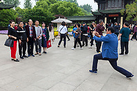 Yangzhou, Jiangsu, China.  Slender West Lake Park.  Man Taking a Photo of Friends.