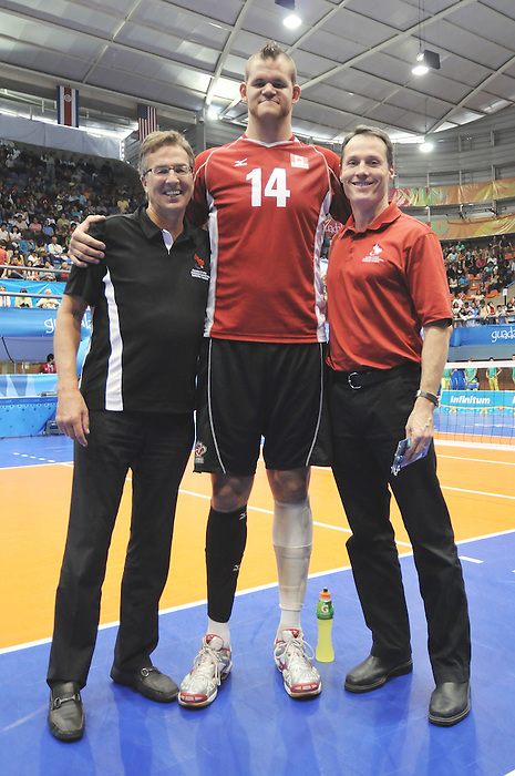 Henry Storgaard, Greg Stewart, and David Legg, Guadalajara 2011 - Sitting Volleyball // Volleyball Assis.<br /> Team Canada defeats Columbia in the Bronze Medal Game // Équipe Canada bat Columbia dans le match pour la médaille de bronze. 11/18/2011.