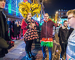 """© Joel Goodman - 07973 332324 . 15/12/2017. Manchester, UK. A club promoter wearing drag hands out flyers to passing revellers wearing Christmas costumes . Revellers out in Manchester City Centre overnight during """" Mad Friday """" , named for historically being one of the busiest nights of the year for the emergency services in the UK . Photo credit : Joel Goodman"""