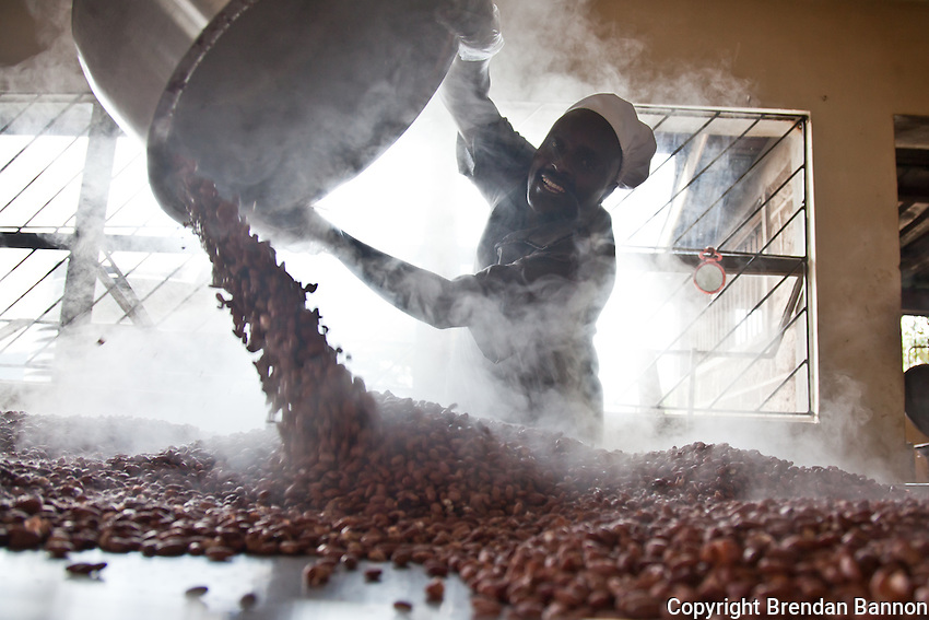 Willex Rotich empties cooked beans on the cooling table at Cherubet, the frozen foods company started in 2007 by Mary Cherop Maritim.