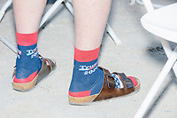 A man wears Trump 2020 campaign socks in Birkenstock sandals as he watches Donald Trump, Jr., son of president Donald Trump and a rising Republican political star, speak at an outdoor campaign rally at The Lobster Trap in North Conway, New Hampshire, on Thu., Sept. 24, 2020.