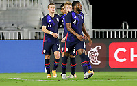 FORT LAUDERDALE, FL - DECEMBER 09: Chris Mueller #11 of the United States heads home a scoring goal and celebrates with team mate Sam Vines #13 and his USMNT during a game between El Salvador and USMNT at Inter Miami CF Stadium on December 09, 2020 in Fort Lauderdale, Florida.