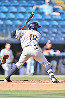 Charleston RiverDogs left fielder Cesar Diaz (10) swings at a pitch during game one of a double header against the Asheville Tourists at McCormick Field on July 8, 2016 in Asheville, North Carolina. The RiverDogs defeated the Tourists 10-4 in game one. (Tony Farlow/Four Seam Images)