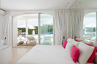 BNPS.co.uk (01202 558833)<br /> Pic: CapVillas/BNPS<br /> <br /> One of the bedrooms has french windows<br />  <br /> A glamorous villa that has hosted a string of celebrities including Winston Churchill, Pablo Picasso, the Duke of Windsor and Edith Piaf is on the market for £9m (10.5m euros).<br /> <br /> The exquisite Villa La Garoupe Beach sits on a natural sand beach and has its own private beach on one of the French Riviera's most exclusive spots.<br /> <br /> It was once a renowned beach club and the list of names connected to the property are endless. French singer Edith Piaf hosted her engagement party to Theo Sarapo there and it was also visited by former US President Harry Truman, writer Ernest Hemingway, Bond actor Sean Connery and movie star Marlene Dietrich.<br /> <br /> The property in Cap d'Antibes has four bedrooms suitable for six to eight people, three bathrooms and a living area overlooking the sea.