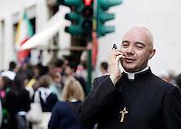 Un prete parla al suo cellulare, nel rione Borgo, Roma, 17 aprile 2011..A priest uses his smartphone, near the Vatican in Rome, 17 april 2011..UPDATE IMAGES PRESS/Riccardo De Luca