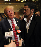 NEW YORK, NY - NOVEMBER 30: Republican Candidate Donald Trump arrives to speaks to the press with Rev. Darrell Scott, senior pastor of the New Spirit Revival Center in Cleveland Heights after meetings with prominent African American clerics at Trump Tower in New York November 30 ,2015.<br /> <br /> People:  Donald Trump