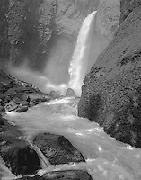 """""""Tower Falls"""" <br /> Yellowstone National Park, Wyoming<br /> <br /> Strong columns of sunlight reached the bottom of the gorge to create exciting illumination at Tower Falls on this fine day. A straightforward black and white photograph effectively captured the effect of the exciting sunlight in the gorge."""