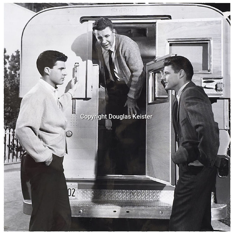 What could be more all-American than the Nelson family? The Adventures of Ozzie and Harriet, which ran on ABC television from 1952–66 tracked the day-to-day lives of the Nelson family and, in particular, the youngest son Ricky who grew into a bona fide teenage heartthrob. In this promotional photograph, Ozzie Nelson emerges from Alaskan Camper while Ricky (on the left) and David stand outside. Harriet is, no doubt, preparing a fine family meal in the camper's tidy galley. Courtesy Alaskan Campers.
