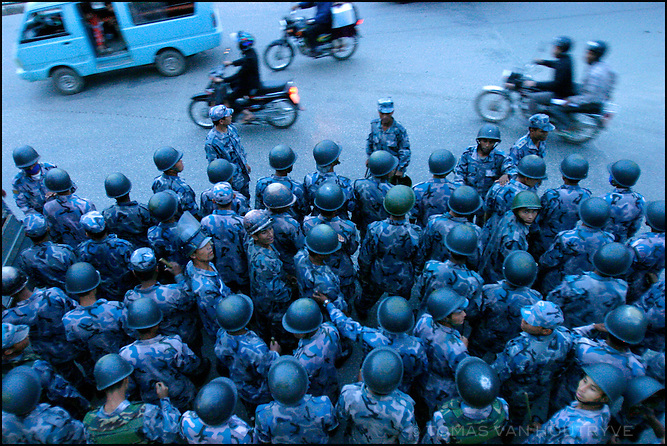 A formation of police prepares to for protesters in Kathmandu, Nepal on 21 April, 2004. Weeks of clashes between police and protesters calling on the king to reinstate democracy lead to thousands of arrests and hundreds injured.<br />