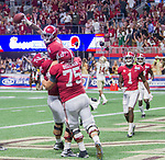 Alabama wide receiver Calvin Ridley (3) celebrates a two point conversion with teammates Ross Pierschbacher (71) and Bradley Bozeman (75) second half of the Chick-fil-A Kickoff game against Florida State at the new Mercedes-Benz Stadium in Atlanta, Georgia on September 2, 2017. Alabama defeated Florida State 24-7.  Photo by Mark Wallheiser/UPI
