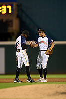 Bradenton Marauders shortstop Maikol Escotto (35) and second baseman Jase Bowen (2) celebrate after closing out a game against the Palm Beach Cardinals on May 29, 2021 at LECOM Park in Bradenton, Florida.  (Mike Janes/Four Seam Images)