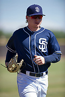 San Diego Padres outfielder Jack Suwinski (8) jogs off the field between innings during an Instructional League game against the Milwaukee Brewers on September 27, 2017 at Peoria Sports Complex in Peoria, Arizona. (Zachary Lucy/Four Seam Images)