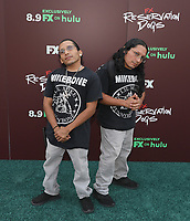 """TULSA, OK - AUGUST 2: Funny Bone and Lil Mike attend the Red Carpet Event for the Series Premiere of FX's """"Reservation Dogs"""" at Circle Cinema on August 2, 2021 in Tulsa, Oklahoma. (Photo by Tom Gilbert/FX/PictureGroup)"""