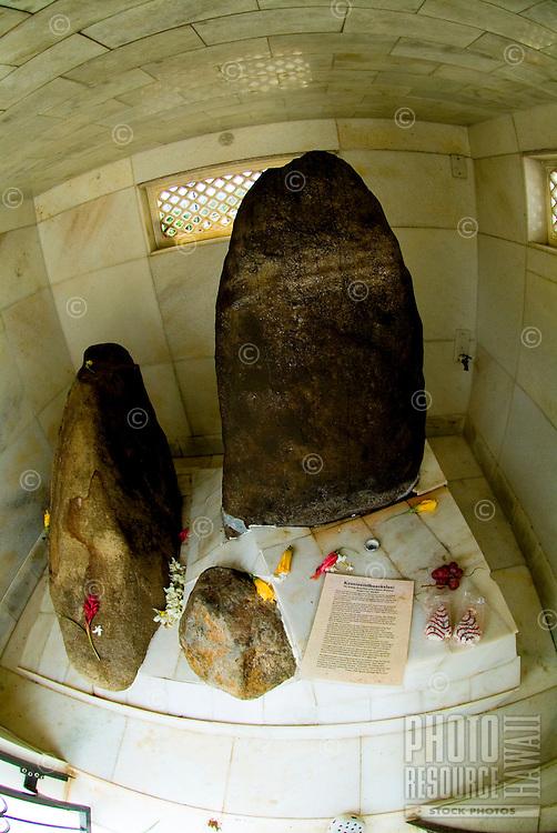 Offerings adorn the ancient sacred healing stones in enclosure at Wahiawa. Hawaiian name: Keanianileihuaokalani.