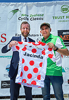 MP Kieran McAnulty is presented with a KOM jersey for Prime Minister Jacinda Ardern by race director Jorge Sandoval (right). Stage three of the NZ Cycle Classic UCI Oceania Tour (Martinborough circuit) in Wairarapa, New Zealand on Friday, 17 January 2020. Photo: Dave Lintott / lintottphoto.co.nz
