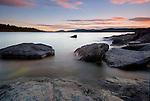 A sunset at the Rotsidan on the Baltic coast near Nordingra, Sweden.  Part of the UENSCO World Heritage Site of the Hight Coast (Höga Kusten), Sweden