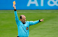 LOS ANGELES, CA - OCTOBER 25: Referee Kevin Stott shows yellow during a game between Los Angeles Galaxy and Los Angeles FC at Banc of California Stadium on October 25, 2020 in Los Angeles, California.