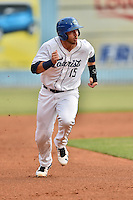 Asheville Tourists designated hitter Brian Mundell (15) runs to third base during a game against the Columbia Fireflies at McCormick Field on June 17, 2016 in Asheville, North Carolina. The Tourists defeated the Fireflies 6-2. (Tony Farlow/Four Seam Images)