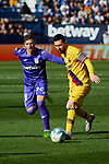 Ruben Perez of CD Leganes and Lionel Messi of FC Barcelona during La Liga match between CD Leganes and FC Barcelona at Butarque Stadium in Leganes, Spain. November 23, 2019. (ALTERPHOTOS/A. Perez Meca)