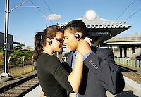 Business couple dance on a rail platform..MR