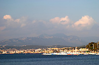 View over the village, the sea, and the mountains, with blue sky and clouds Le Brusc Six Fours Var Cote d'Azur France