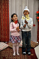 Children hold flowers at a wedding reception of British/Punjabi couple Lindsay and Navneet Singh at the family home in Amritsar.