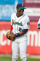 Cedar Rapids Kernels outfielder J.D. Williams (2) laughts prior to a game against the Lansing Lugnuts at Veterans Memorial Stadium on April 29, 2013 in Cedar Rapids, Iowa. (Brace Hemmelgarn/Four Seam Images)