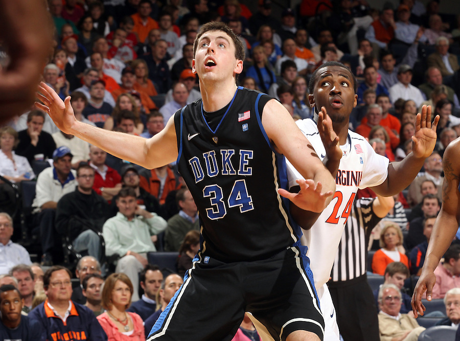 Feb. 16, 2011; Charlottesville, VA, USA; Duke Blue Devils forward Ryan Kelly (34) looks for the rebound next to Virginia Cavaliers guard K.T. Harrell (24) during the second half of the game at the John Paul Jones Arena. The Duke Blue Devils won 56-41.  Credit Image: © Andrew Shurtleff