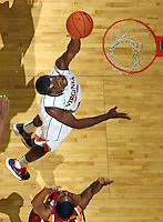 Dec. 30, 2010; Charlottesville, VA, USA; Virginia Cavaliers forward Mike Scott (23) shoots the ball in front of Iowa State Cyclones forward Calvin Godfrey (15) during the game at the John Paul Jones Arena. Iowa State Cyclones won 60-47. Mandatory Credit: Andrew Shurtleff