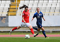 20190304 - LARNACA , CYPRUS : Austrian Barbara Dunst pictured shooting towards goal past Slovakian Andrea Horvathova (r) during a women's soccer game between Slovakia and Austria , on Monday 4 th March 2019 at the GSZ Stadium in Larnaca , Cyprus . This is the third and last game in group C for both teams during the Cyprus Womens Cup 2019 , a prestigious women soccer tournament as a preparation on the Uefa Women's Euro 2021 qualification duels. PHOTO SPORTPIX.BE | DAVID CATRY