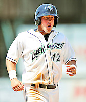 15 July 2010: Vermont Lake Monsters' outfielder Wade Moore comes home to score the winning run against the Aberdeen IronBirds at Centennial Field in Burlington, Vermont. The Lake Monsters rallied in the bottom of the 9th inning to defeat the IronBirds 7-6 notching their league leading 20th win of the 2010 NY Penn League season. Mandatory Credit: Ed Wolfstein Photo
