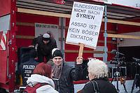 """Rechte und Querfrontanhaenger demonstrieren gegen Syrienkrieg.<br /> Ca. 100 Menschen kamen am Samstag den 12. Dezember 2015 in Berlin zu einer """"Friedensdemonstration"""" gegen eine Beteiligung Deutschlands am Syrienkrieg. Unter ihnen etliche Teilnehmer an montaeglichen Pegidaversammlungen, Mitglieder der rechten Querfrontorganisation """"Endgame"""", Hooligans und NPD-Sympathiesanten.<br /> Im Bild: Ein Demonstrant mit einem Schild auf dem er behauptet """"Assad ist kein boeser Diktator"""".<br /> 12.12.2015, Berlin<br /> Copyright: Christian-Ditsch.de<br /> [Inhaltsveraendernde Manipulation des Fotos nur nach ausdruecklicher Genehmigung des Fotografen. Vereinbarungen ueber Abtretung von Persoenlichkeitsrechten/Model Release der abgebildeten Person/Personen liegen nicht vor. NO MODEL RELEASE! Nur fuer Redaktionelle Zwecke. Don't publish without copyright Christian-Ditsch.de, Veroeffentlichung nur mit Fotografennennung, sowie gegen Honorar, MwSt. und Beleg. Konto: I N G - D i B a, IBAN DE58500105175400192269, BIC INGDDEFFXXX, Kontakt: post@christian-ditsch.de<br /> Bei der Bearbeitung der Dateiinformationen darf die Urheberkennzeichnung in den EXIF- und  IPTC-Daten nicht entfernt werden, diese sind in digitalen Medien nach §95c UrhG rechtlich geschuetzt. Der Urhebervermerk wird gemaess §13 UrhG verlangt.]"""