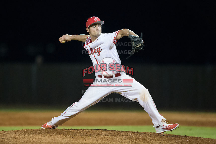 Belmont Abbey Crusaders relief pitcher Parker MacPhail (24) delivers a pitch to the plate against the Catawba Indians at Abbey Yard on February 7, 2017 in Belmont, North Carolina.  The Crusaders defeated the Indians 12-9.  (Brian Westerholt/Four Seam Images)