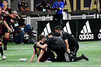 ATLANTA, GA - APRIL 24: Atlanta United midfielder #11 Brooks Lennon is attended to by the team medical staff during a game between Chicago Fire FC and Atlanta United FC at Mercedes-Benz Stadium on April 24, 2021 in Atlanta, Georgia.
