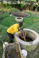 KENYA, County Kakamega, Bukura, village Eshibeye, small biogas plant at milk cow farm / KENIA, kleine Biogasanlage auf einer Milchkuhfarm