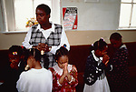 Sunday school children Bible study. Church of God of Prophecy West London UK. <br /> <br /> From A STORM IS PASSING OVER a Look at Black Churches in Britain. Published by Thames and Hudson isbn 0 500 27826 1