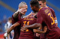 Calcio, Serie A: Roma vs Udinese. Roma, stadio Olimpico, 20 agosto 2016.<br /> Roma's Mohamed Salah, back to camera, celebrates with teammates after scoring during the Italian Serie A football match between Roma and Udinese at Rome's Olympic stadium, 20 August 2016. Roma won 4-0.<br /> UPDATE IMAGES PRESS/Riccardo De Luca